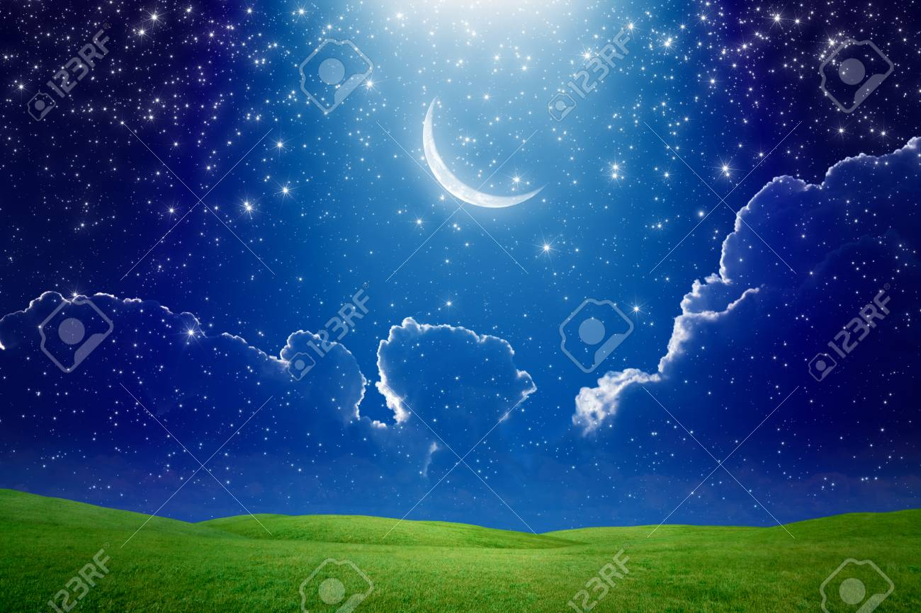 Amazing wallpaper - crescent moon in dark blue starry sky, bright light beam from skies