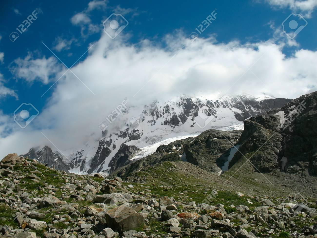 landscape with high mountains, snowy peaks and blue sky Stock Photo - 2024747