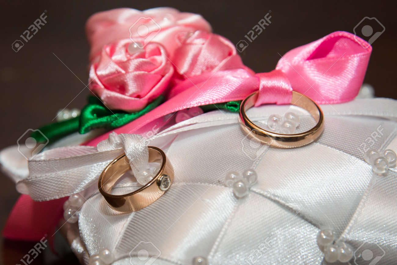 Two Beautiful Wedding Rings Lie On The Pad Stock Photo, Picture And ...