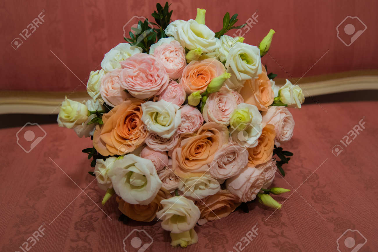 Beautiful Wedding Bouquet Of Pink White Orange Roses And Green