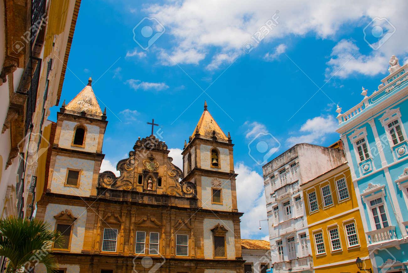 Bright view of Pelourinho in Salvador, Brazil, dominated by the large colonial Cruzeiro de Sao Francisco Christian stone cross in the Pra a Anchieta, America - 122286728