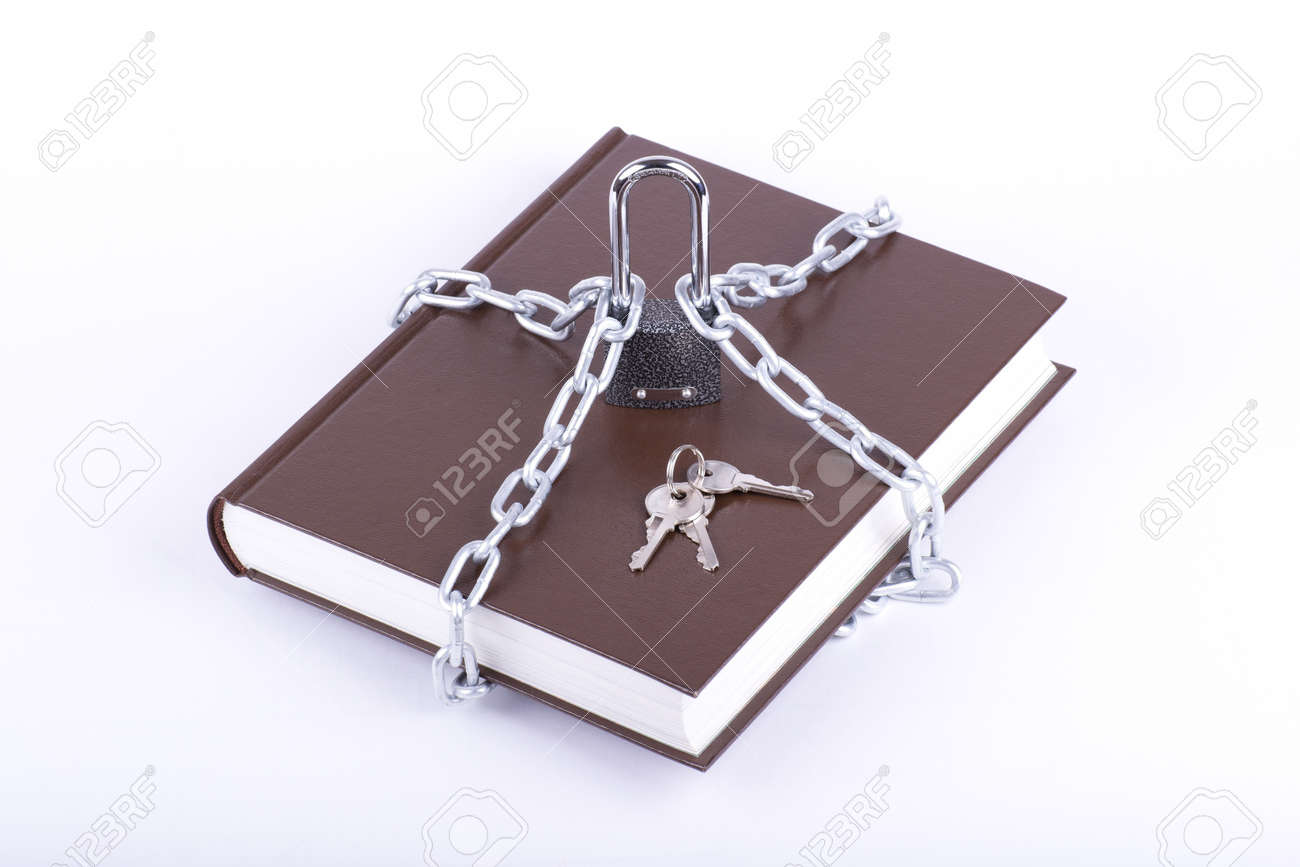 The brown book is linked chain and padlock isolated Stock Photo - 12075412
