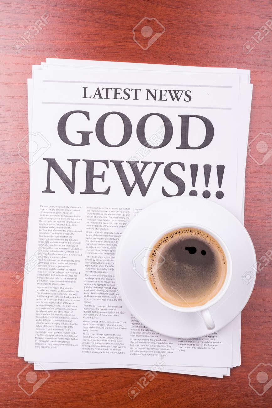 The newspaper LATEST NEWSwith the headline GOOD NEWS and coffee