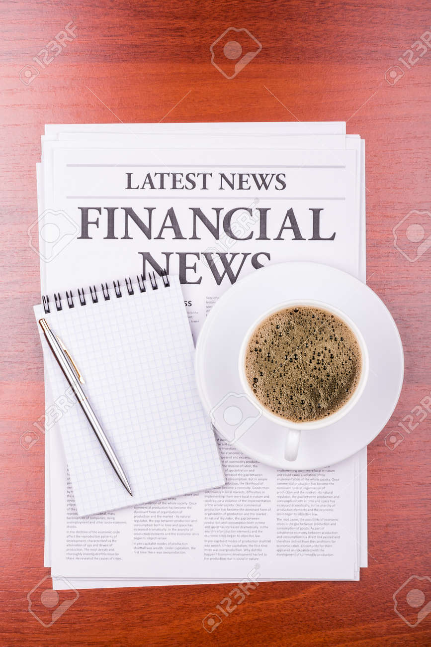 The newspaper LATEST NEWSwith the headline  FINANCIAL NEWS  and coffee Stock Photo - 13200047