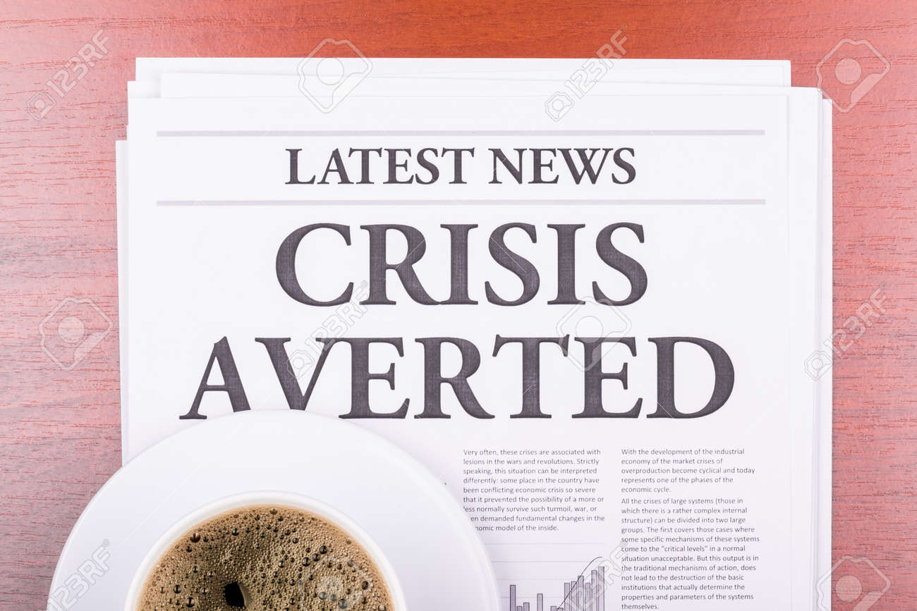 The newspaper LATEST NEWSwith the headline CRISIS AVERTED and