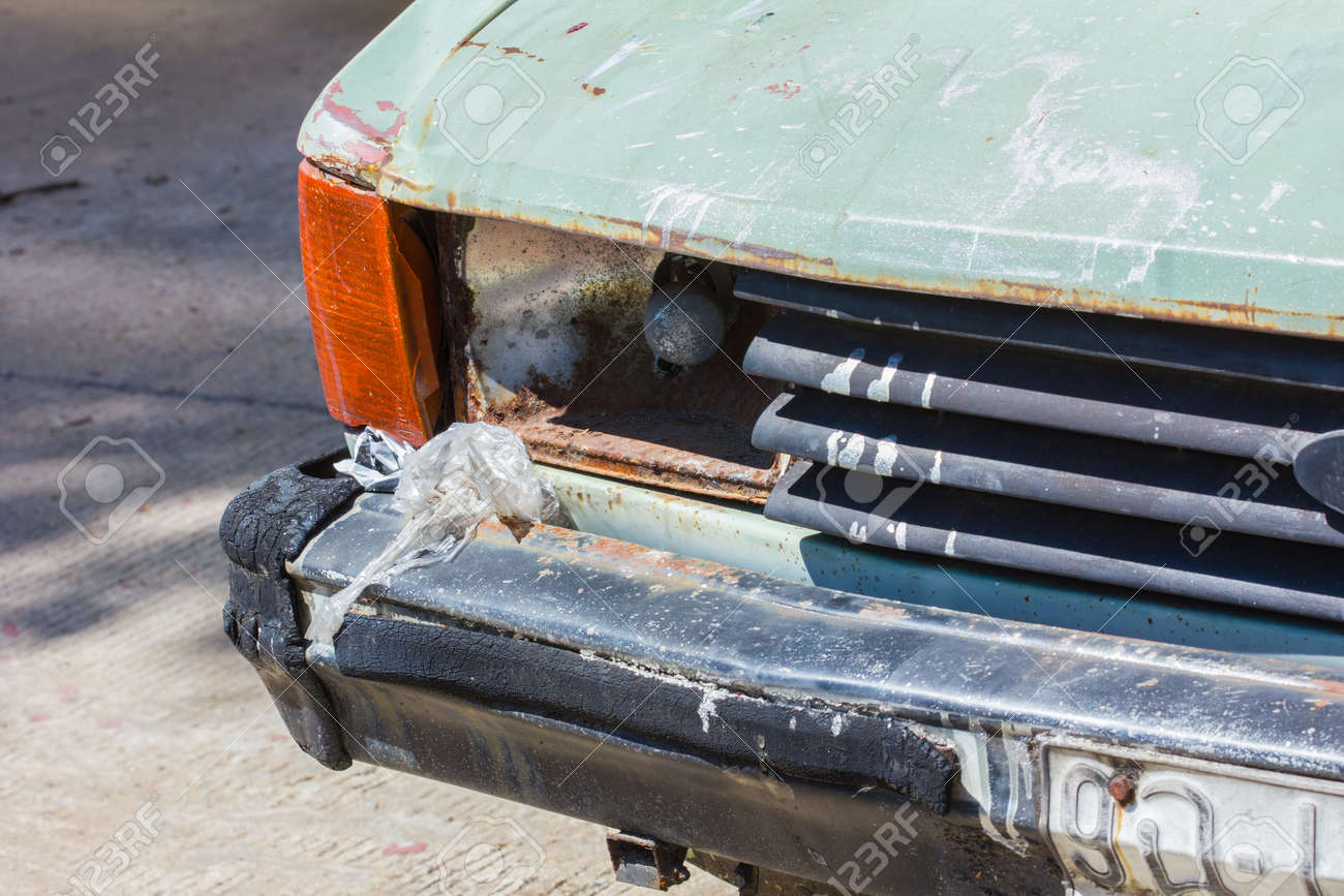 Close Up Shot Of A Junked Car Left In A Car Park. Stock Photo ...