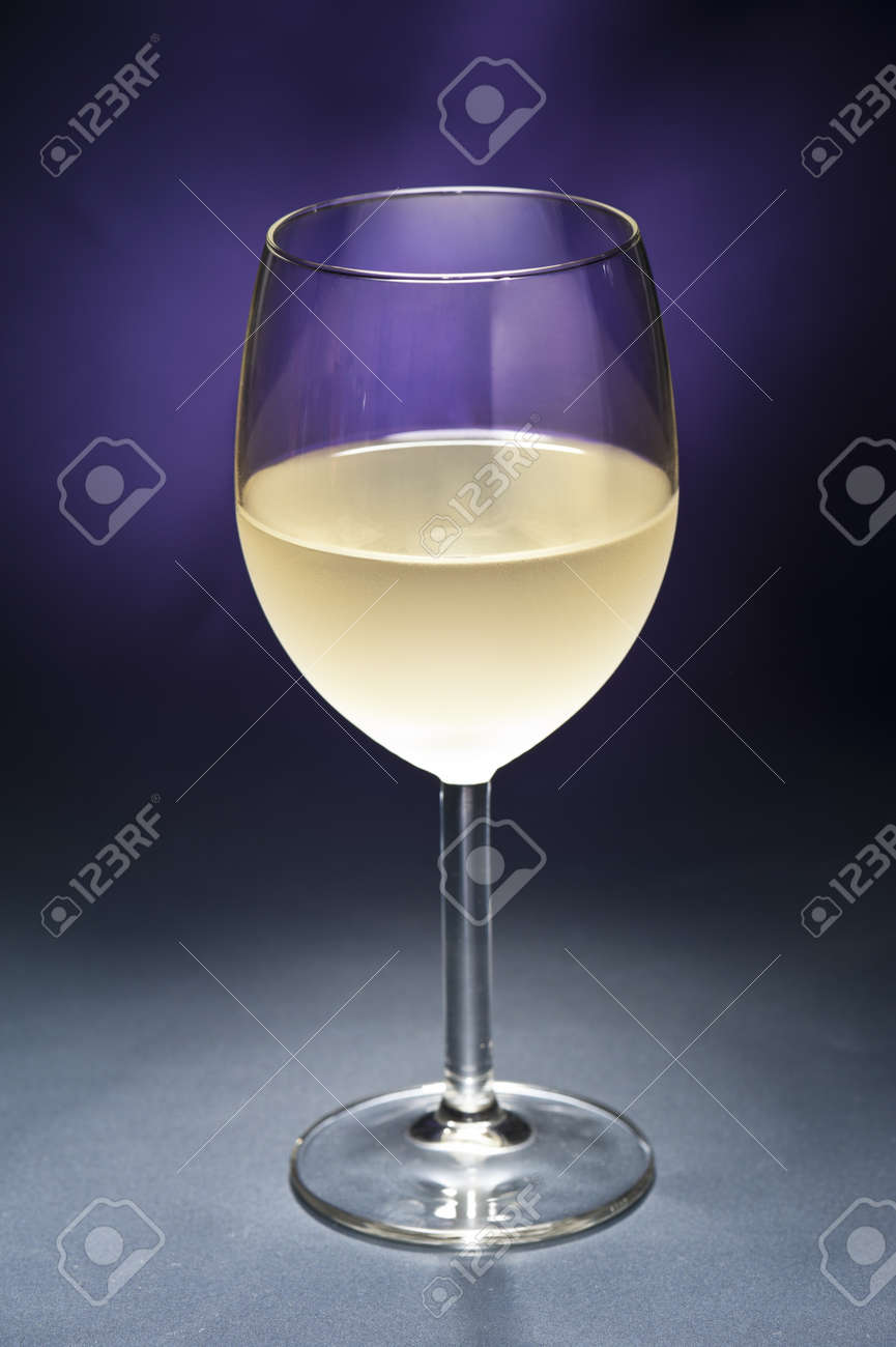 White Wine in front of beautiful purple background Stock Photo - 12233047