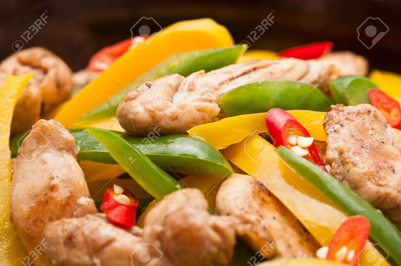 Fried Chicken with capsicum on red table cloth shoot in a studio Stock Photo - 12762208
