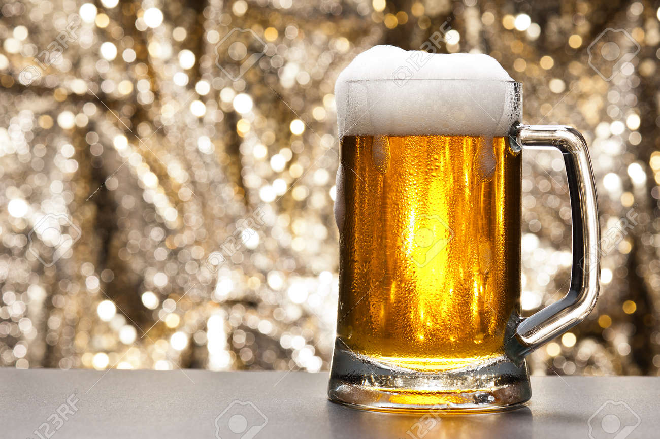 beer mug in front of a glittering background with a cool beer stock
