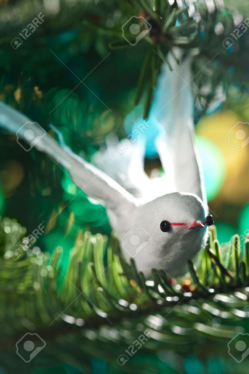 Decorative bird shape ornament in a Christmas tree Stock Photo - 14463226