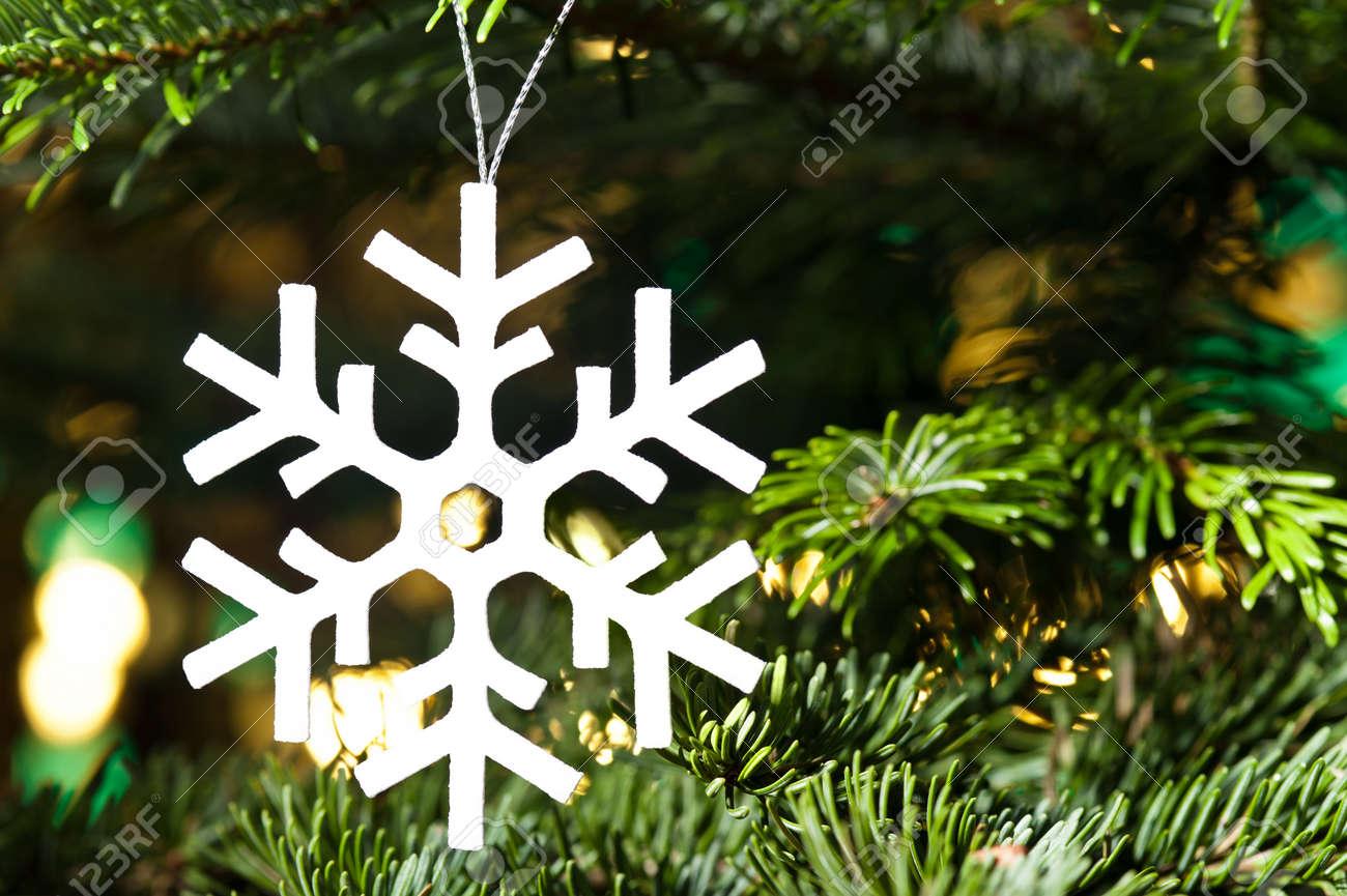 White artificial snowflake in Christmas tree Stock Photo - 14800949