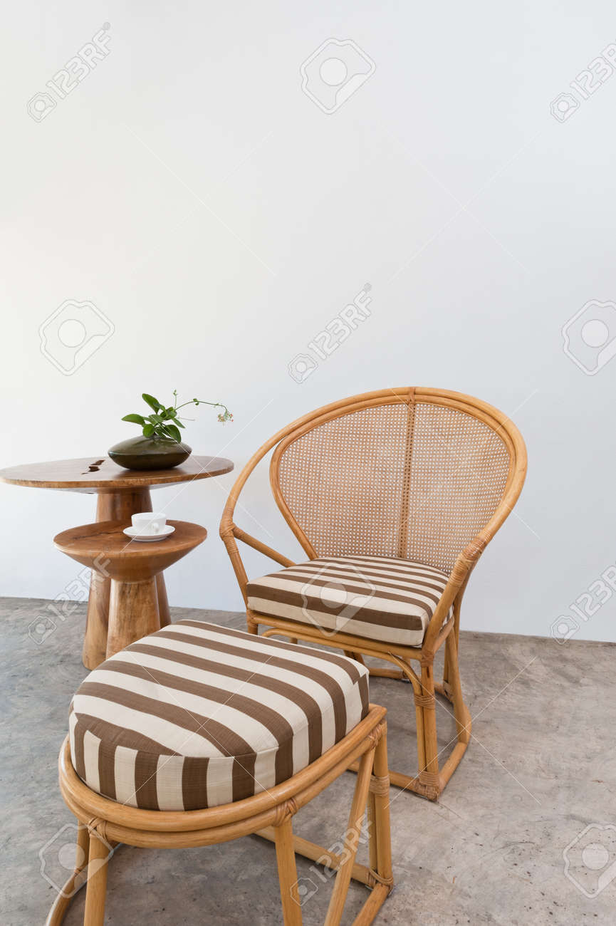 Charming Beautiful Beige Bamboo Rattan Furniture In Front Of A White Wall Stock  Photo   18288112