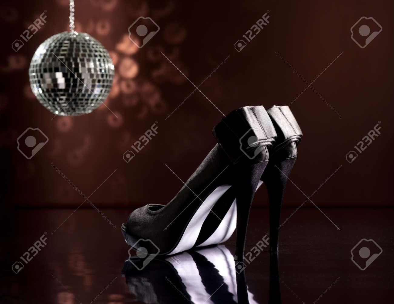 Beautiful black stilettos on the dance floor Stock Photo - 18635010