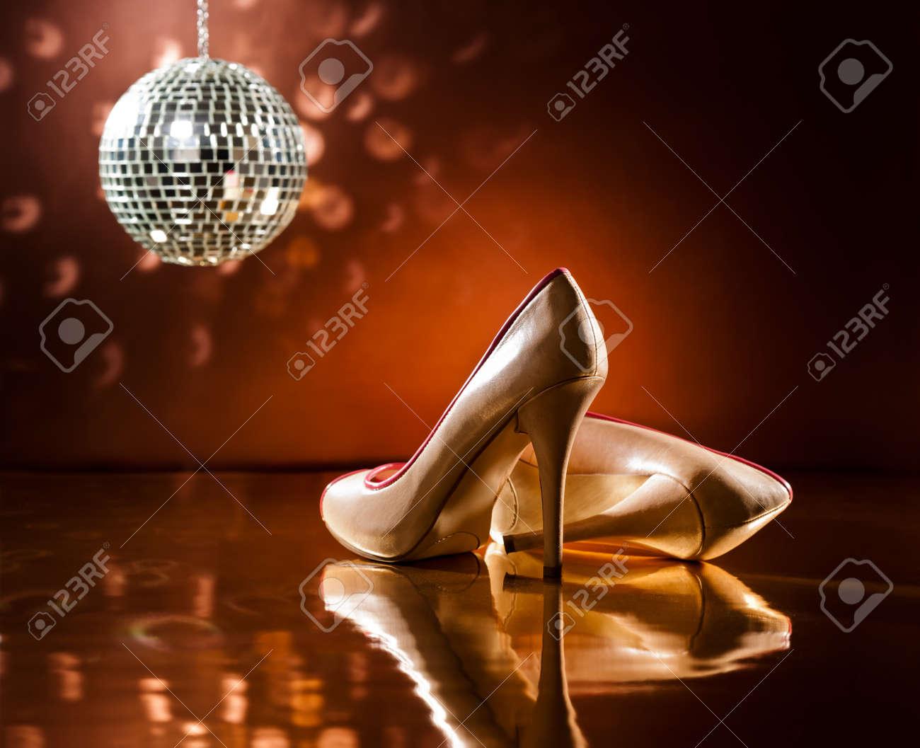 Beautiful brown stilettos on the dance floor with mirror ball Stock Photo - 18786771