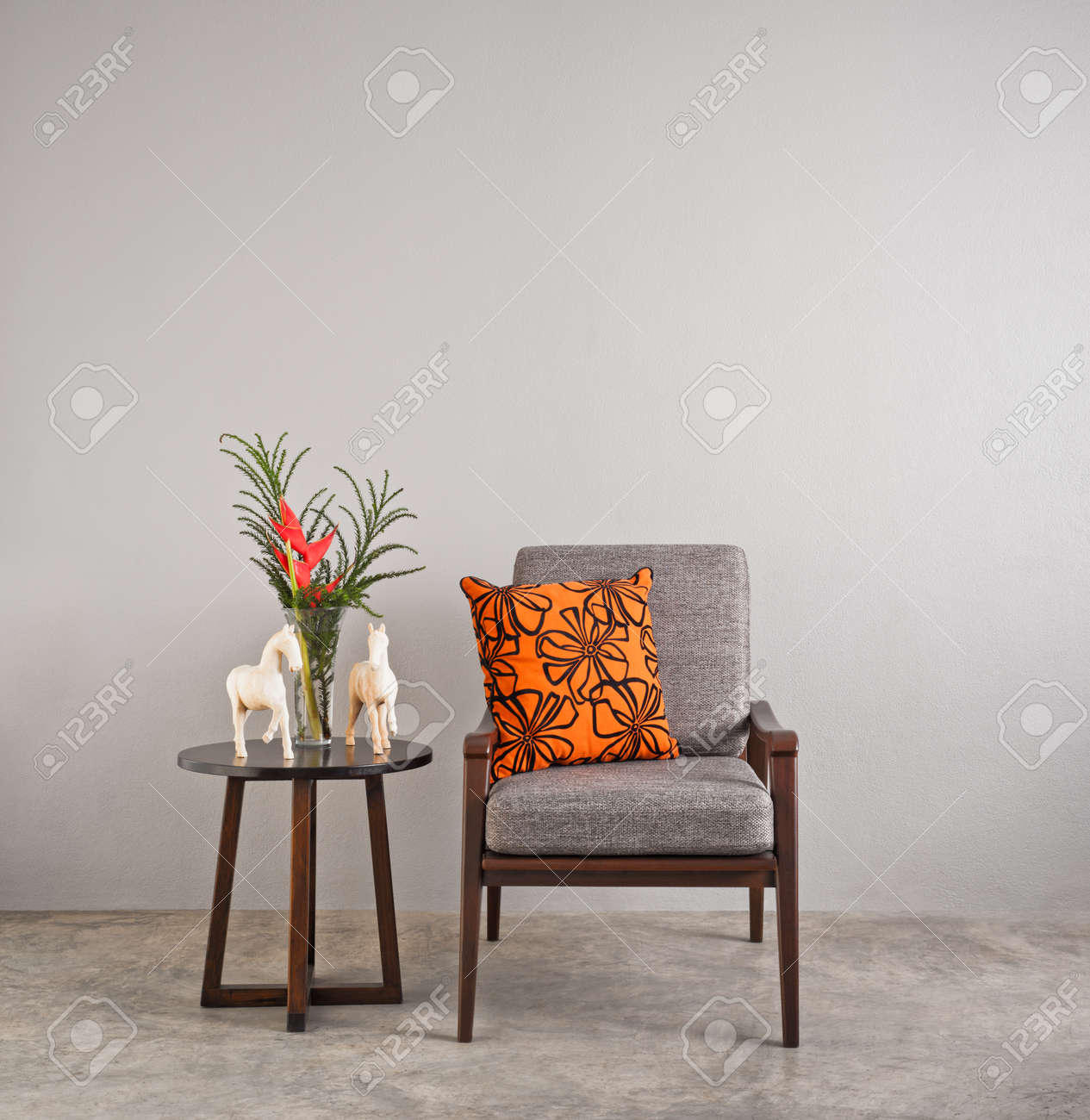 Grey Upholstered Chair In Living Room With Flowers Stock Photo ...