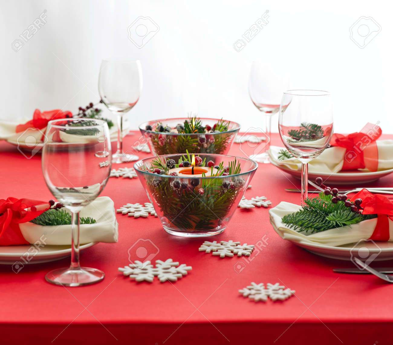 Red Christmas dinner table setup with snow flake decoration Stock Photo -  26923573