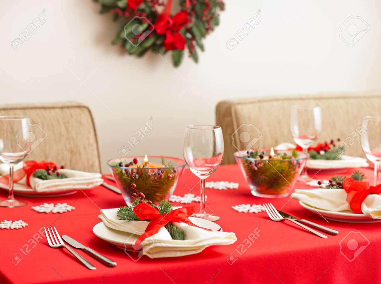 Christmas Dinner Table Setting With Real Tree Decoration Stock Photo