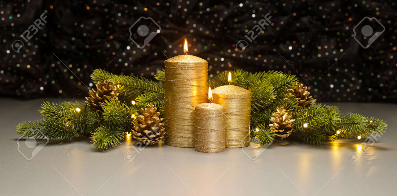 Pine Cone Candles Three Golden Candles With Christmas Tree Branches And Pine Cones