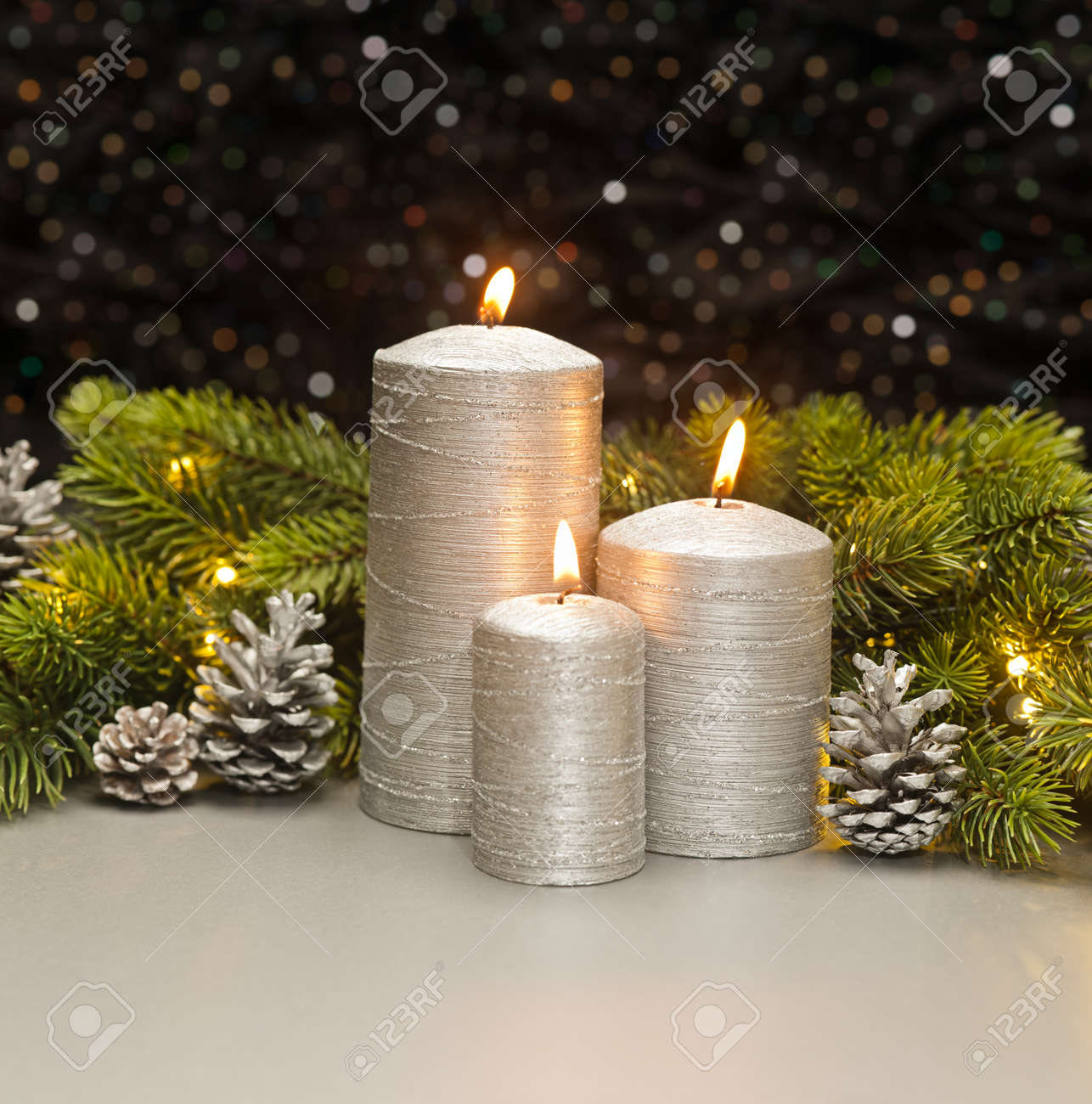 Pine Cone Candles Three Silver Candles With Christmas Tree Branches And Pine Cones