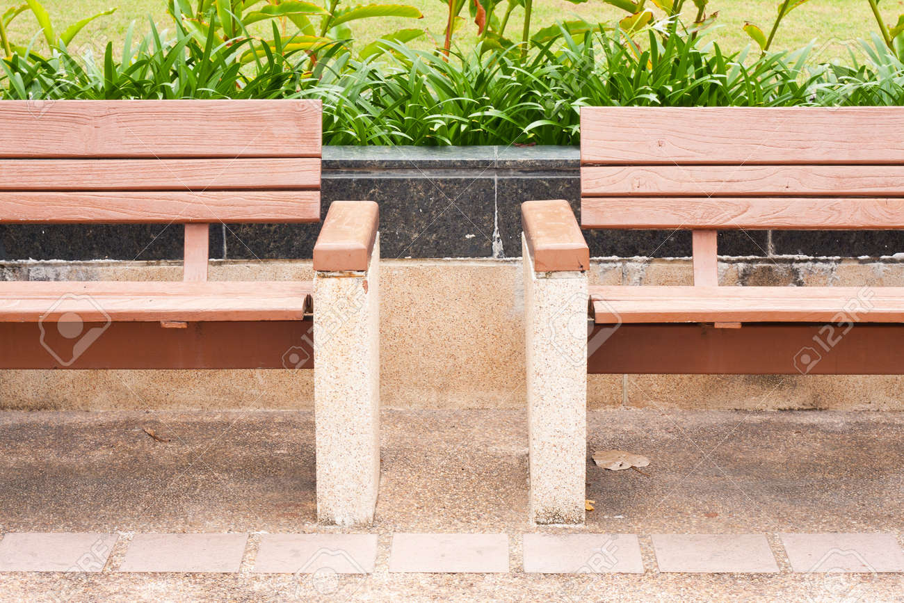 bench on the sidewalk in the park Stock Photo - 6956367