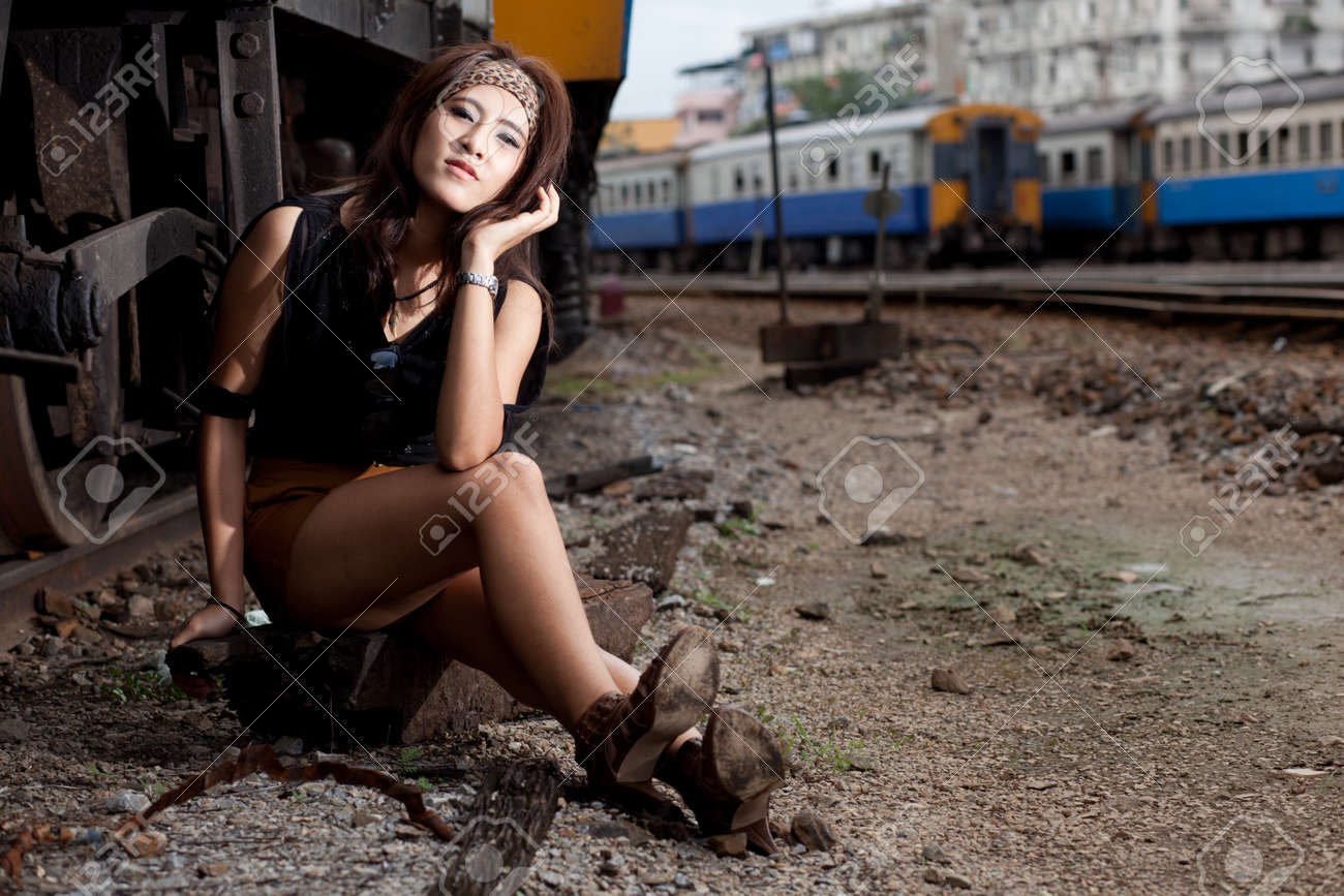 fashion portrait beauty asian girl in train station.portrait fashion outdoor. Stock Photo - 11013043