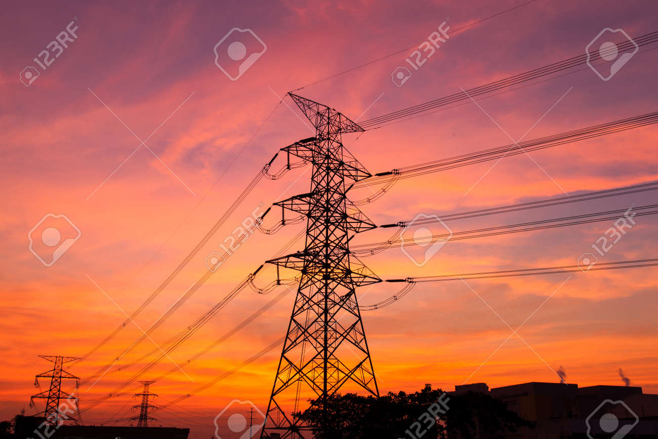 High voltage towers. The electric power industry and infrastructure. The sun is about to fall. Stock Photo - 17845728
