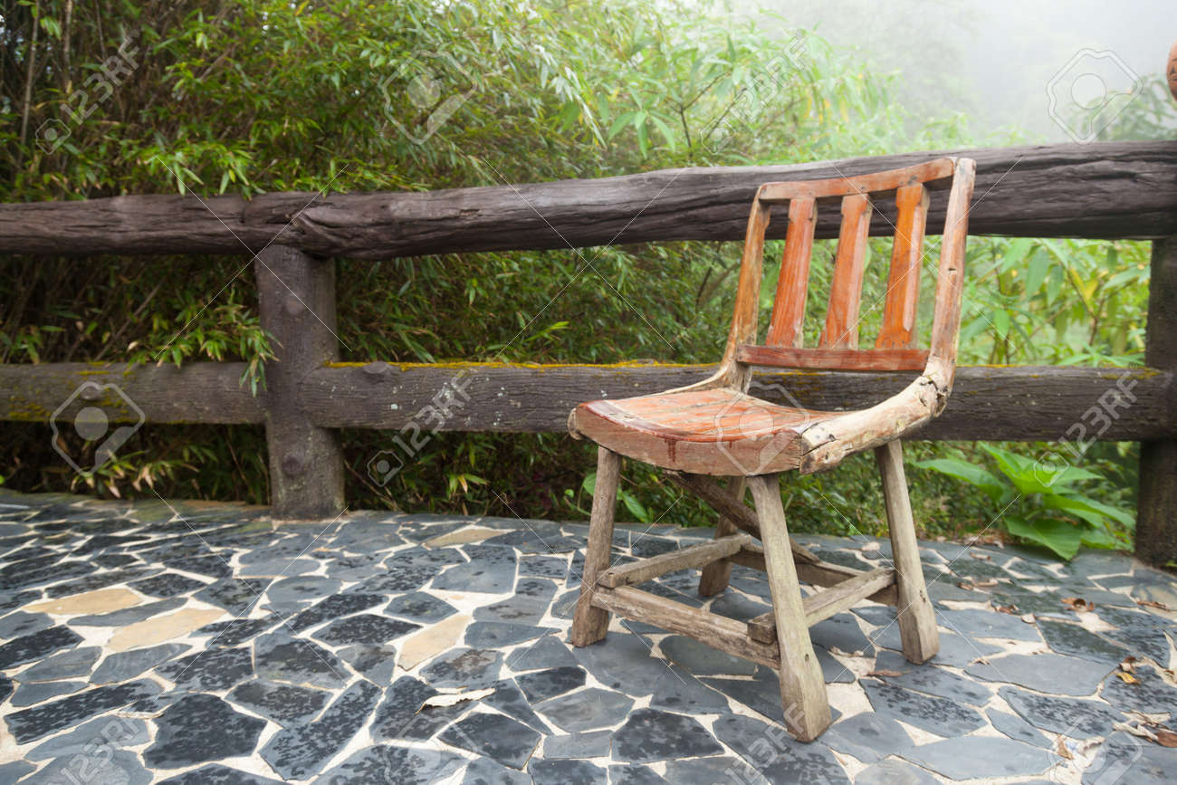 Wooden Chair On The Balcony. Decking Made Of Stone The Outside Terrace Is A  Tree