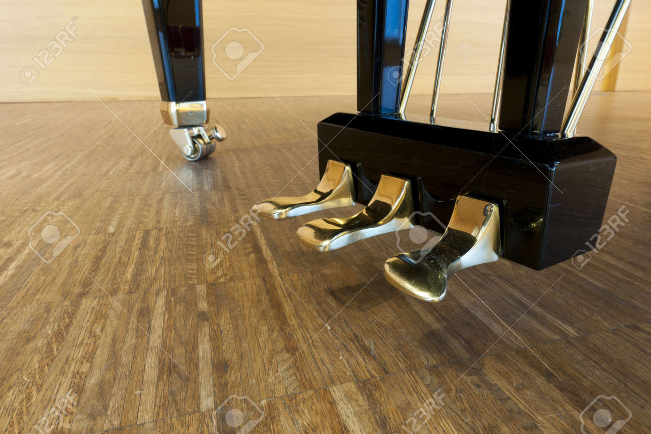 golden piano pedals of a concert grand piano standing on concert stage Stock Photo - 11567349