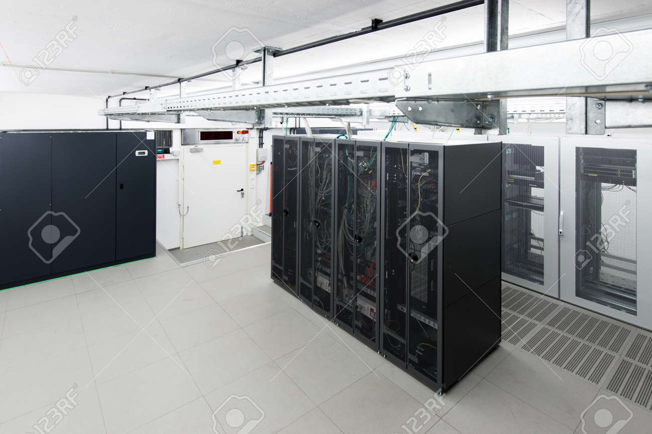 small air conditioned server room with black racks and climate