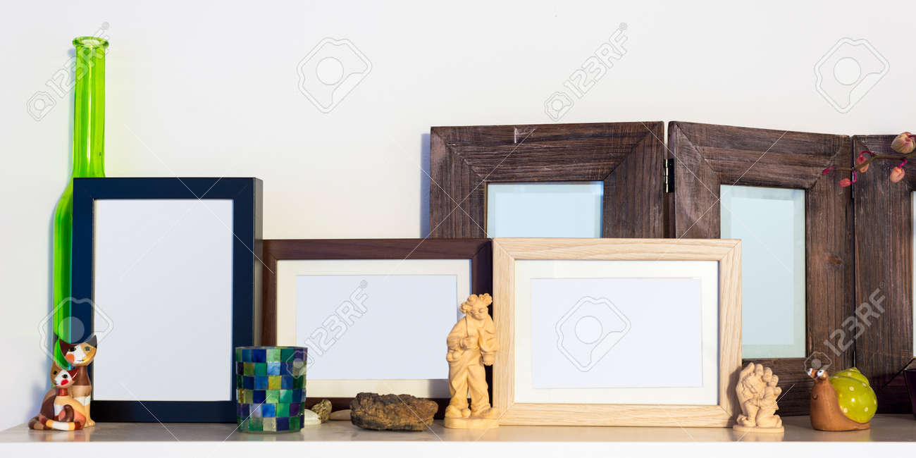 Several Wooden Pictures Frames Standing On Shelf Stock Photo ...