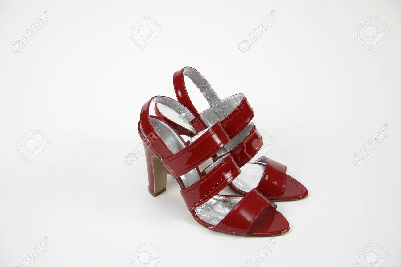 Ladies Red Shoes Glossy With A High Heels On White Background Stock