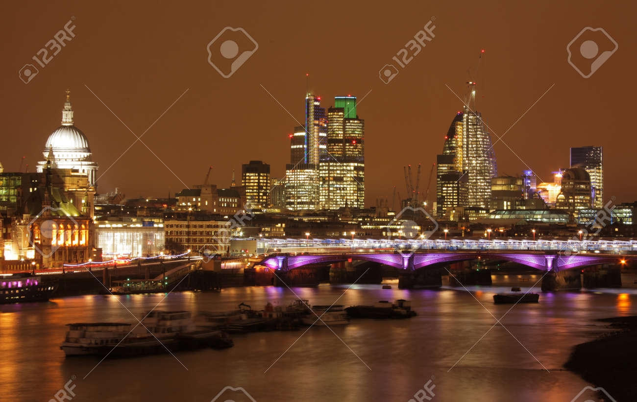Night skyline of London with St  Pauls cathedral and commercial buildings as seen from the Waterloo bridge Stock Photo - 18673331