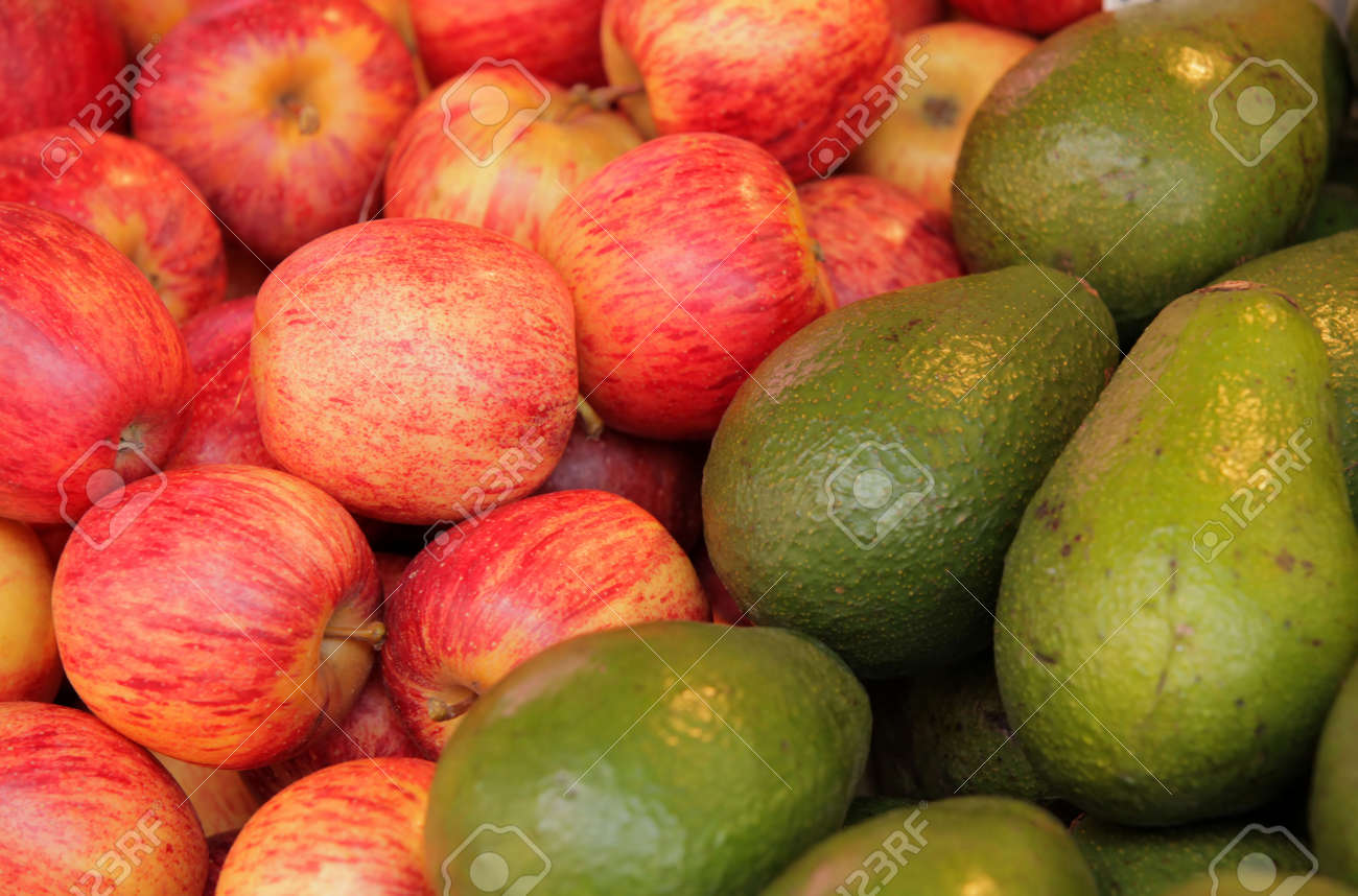 Red apples and avocadoes on sale on a farmers market in Brixton Stock Photo - 20950220