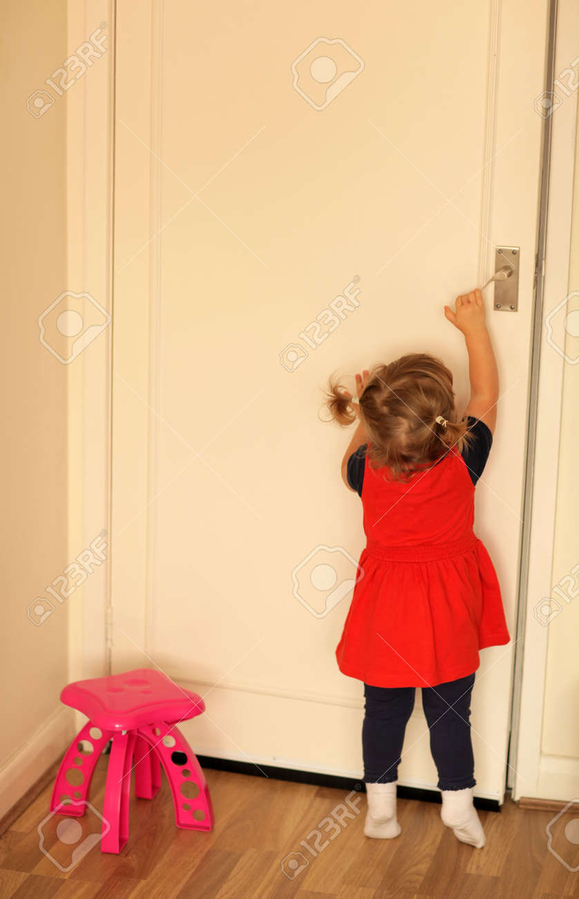 Cute little baby girl trying to open room doors Stock Photo - 21692142 & Cute Little Baby Girl Trying To Open Room Doors Stock Photo ... pezcame.com
