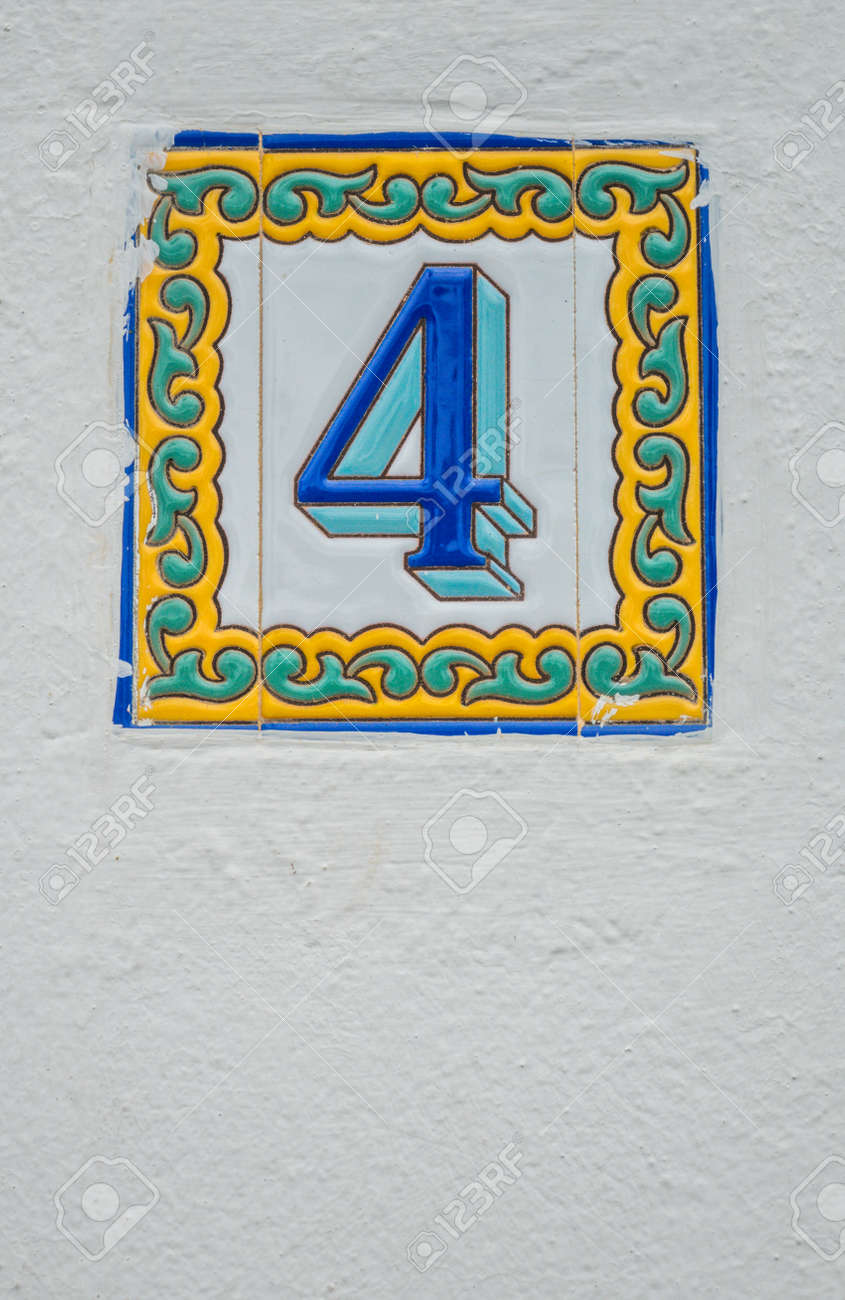Old Door Plaque With The Number 4 On A Wall Of A Home In Gran Canaria