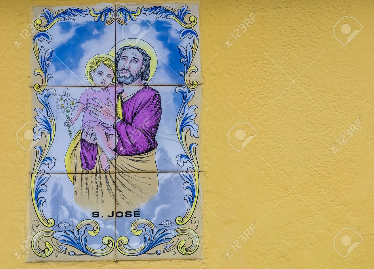 Porcelain Plaque Depicting The Holy Family On The Wall Above.. Stock ...