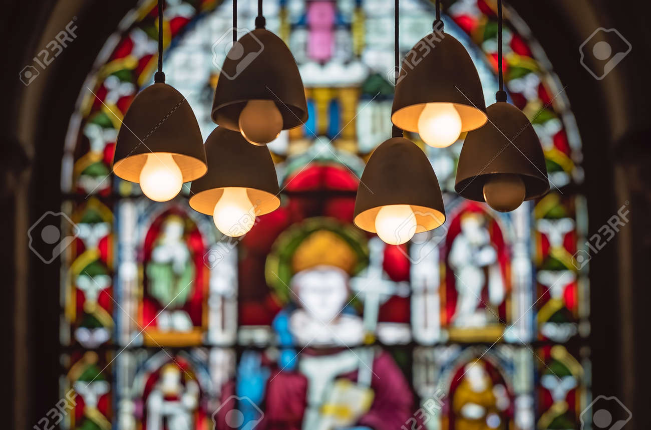 Victorian Stained Glass Church Window With Lamps Hanging From Stock Photo Picture And Royalty Free Image Image 109671723