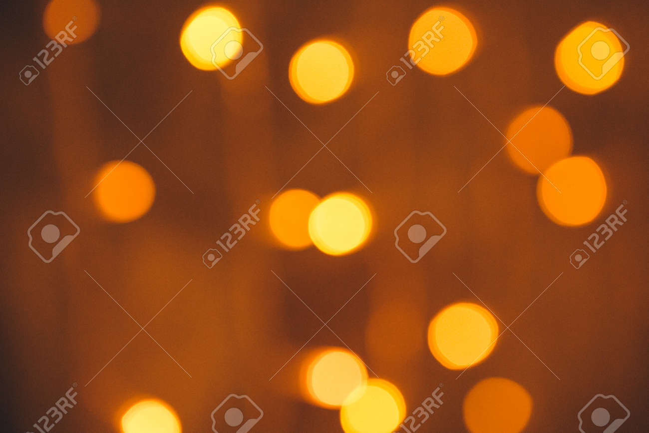 Many blurred small electric bulbs on a wall yellow blurred lights foto de archivo many blurred small electric bulbs on a wall yellow blurred lights wall of christmas lights aloadofball Image collections