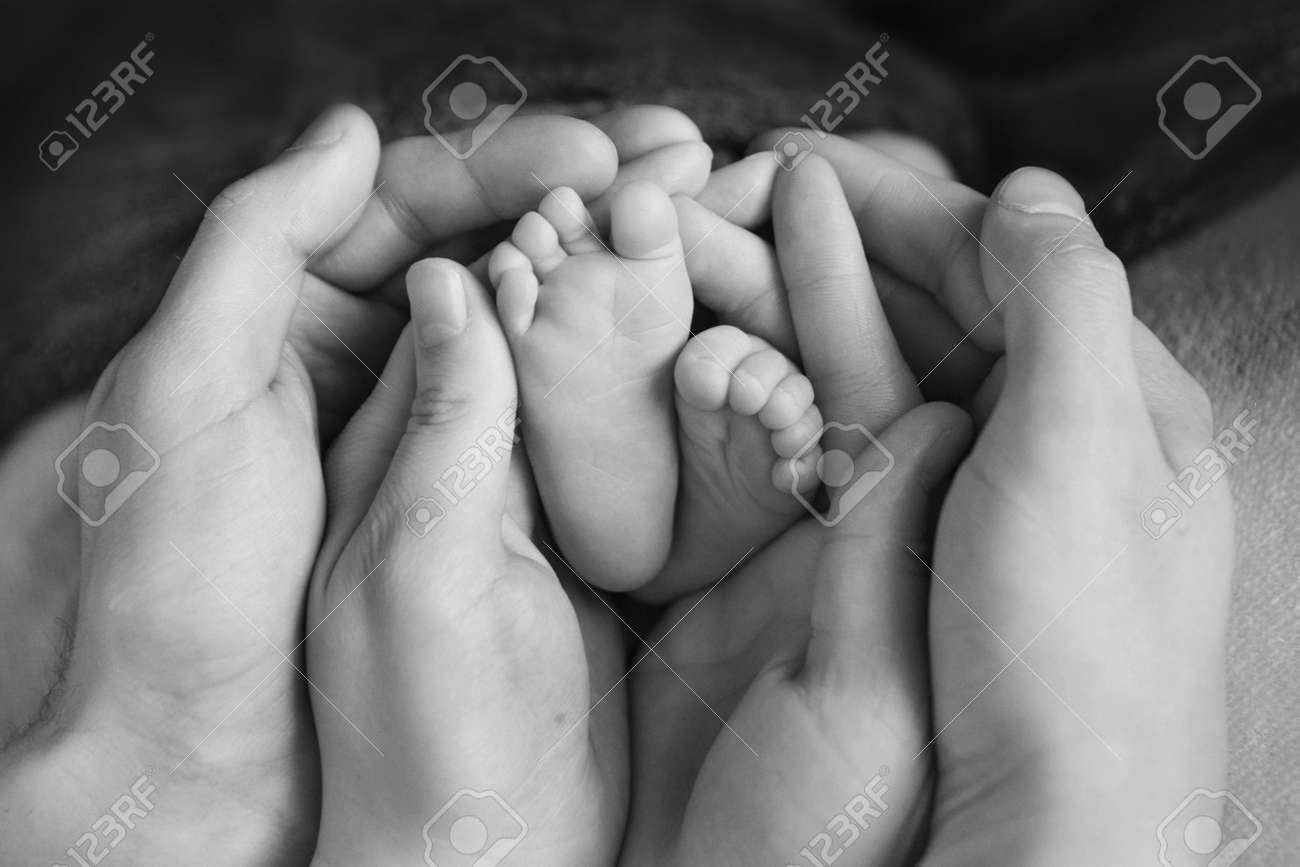 Newborn babys feet mother holding newborn baby legslegs massage stock photo 108110637
