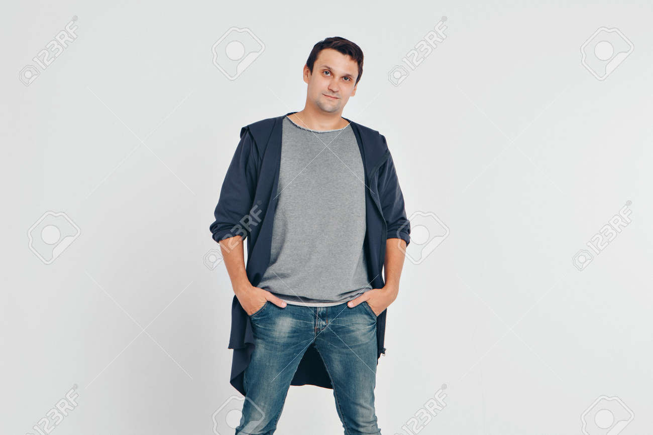 handsome man shows off gray clothes on white background - 120938251