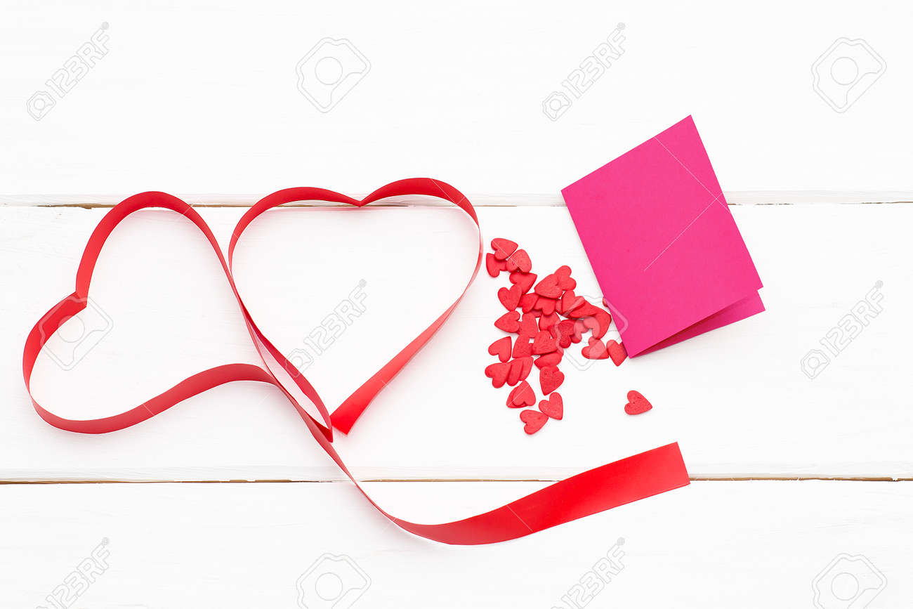 Clip Art Line Of Hearts : Two hearts of red ribbon with a few small and greeting
