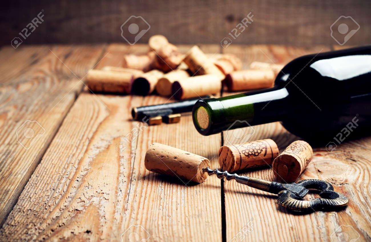 Still Life, Food And Drink, Holidays Concept. Wine Corks, Bottle And  Corkscrew