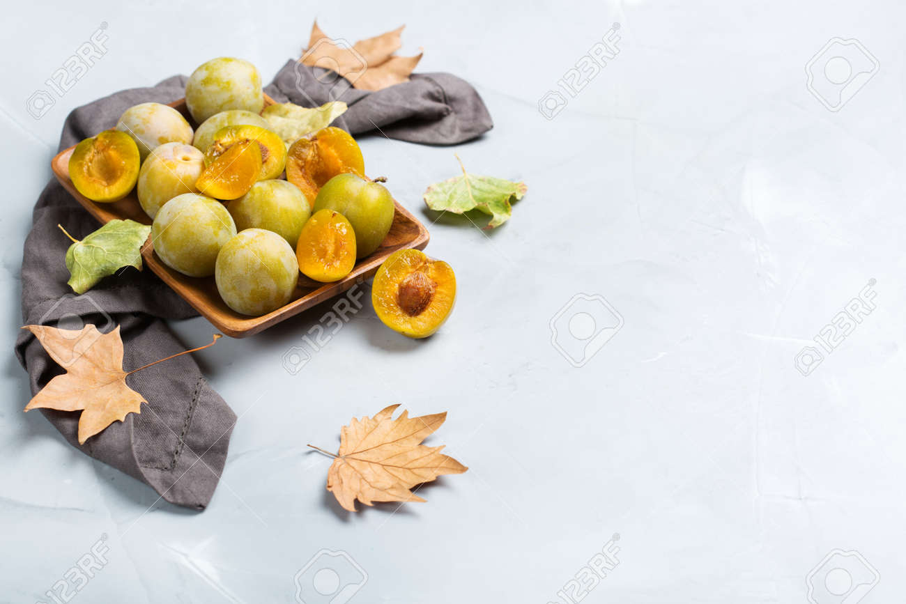 Autumn Fall Harvest Concept. Ripe Juicy Yellow Plums On A Cozy ...