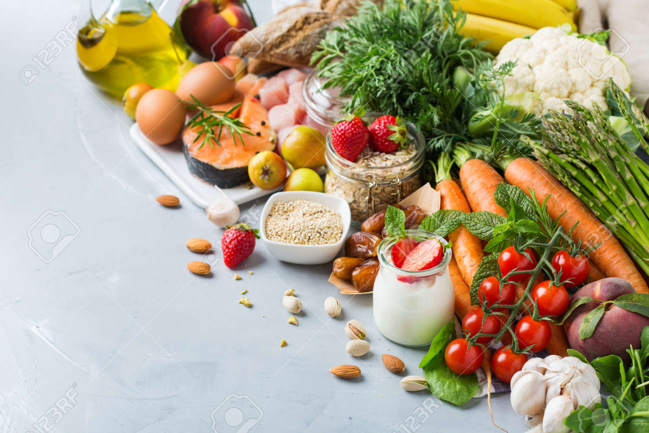 Balanced nutrition concept for DASH clean eating flexitarian mediterranean diet to stop hypertension and low blood pressure. Assortment of healthy food ingredients for cooking on a kitchen table. - 131730443