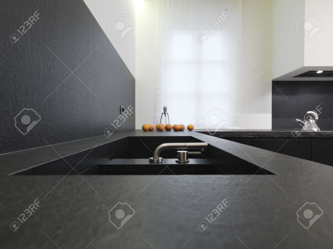 steel faucet for a black marble sink for a modern kitchen Stock Photo - 8929869
