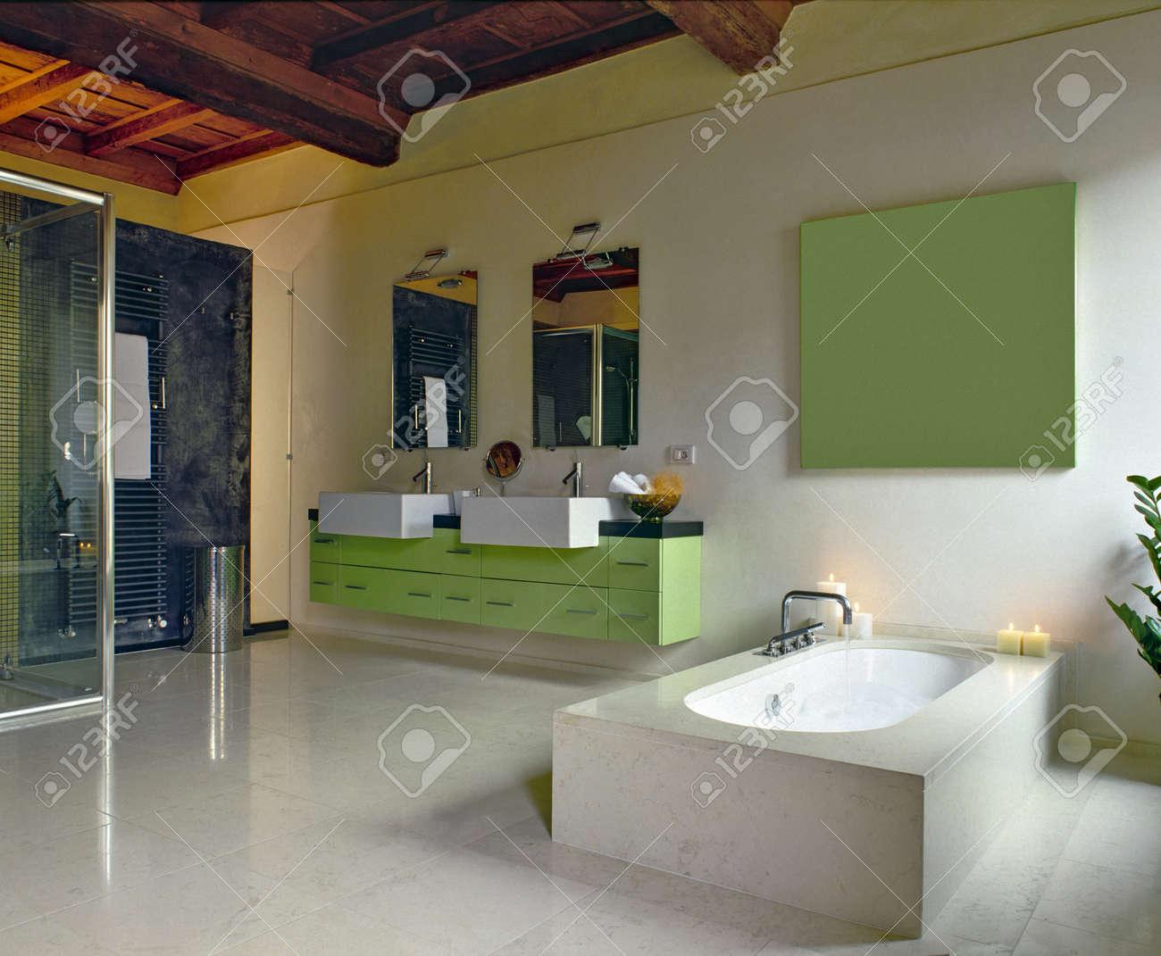 green furniture in a modern bathroom and bathtub Stock Photo - 13615167