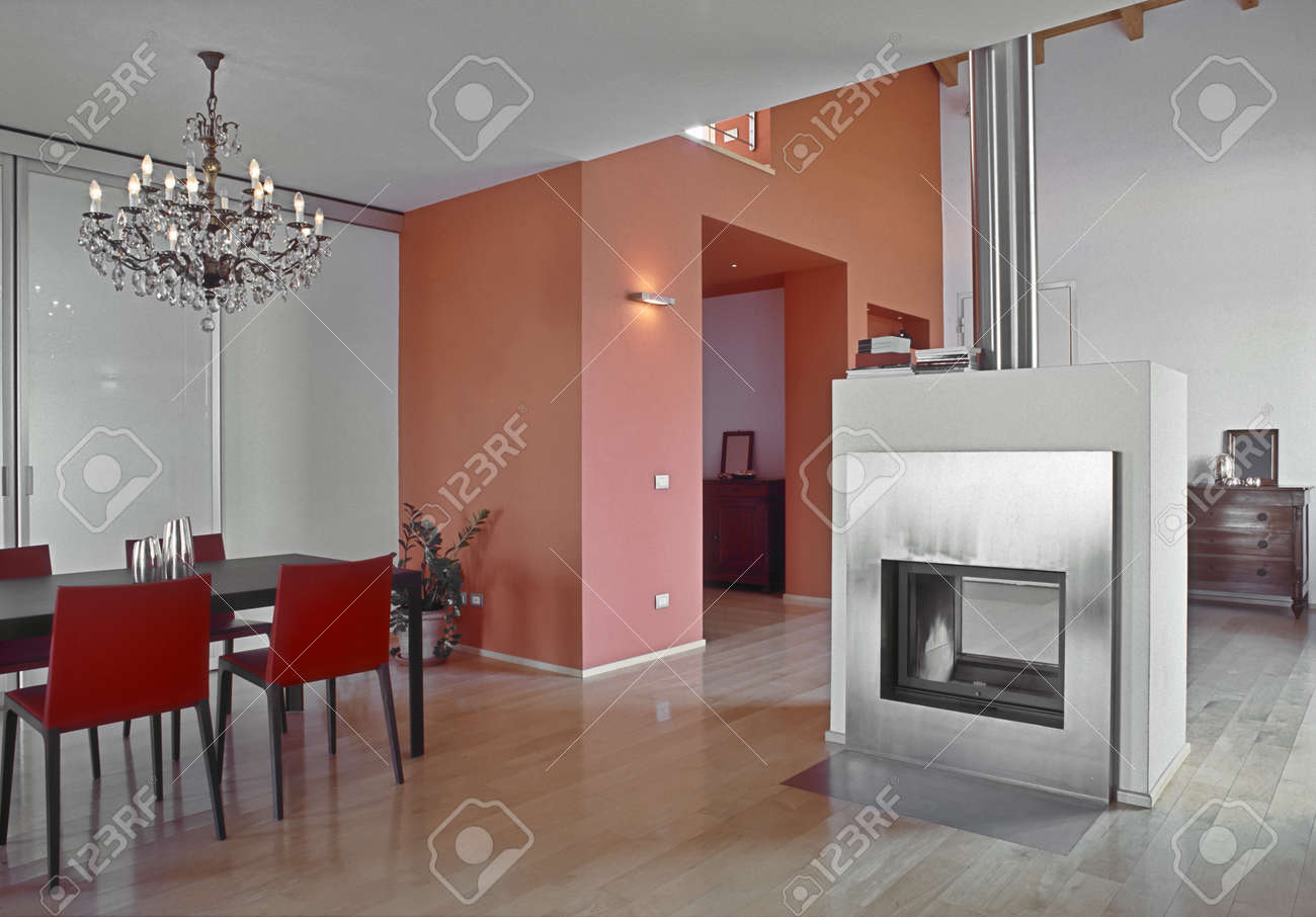 Modern Dining Room With Wood Floor And Fireplace Stock Photo