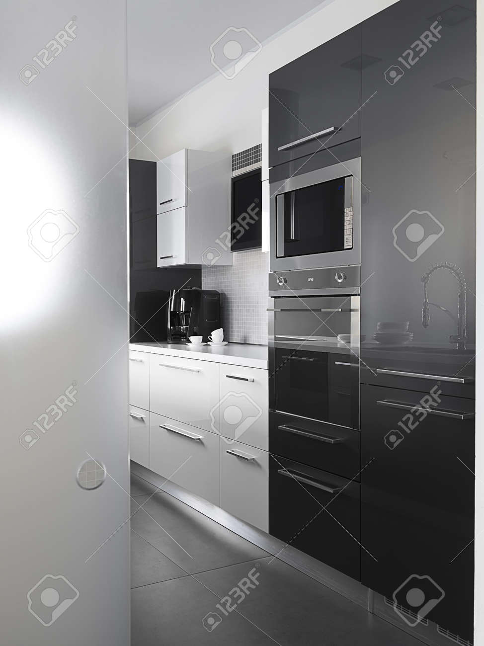 Gray Tile Floor Kitchen Modern Kitchen With Gray Tile Floor And White Wall Stock Photo