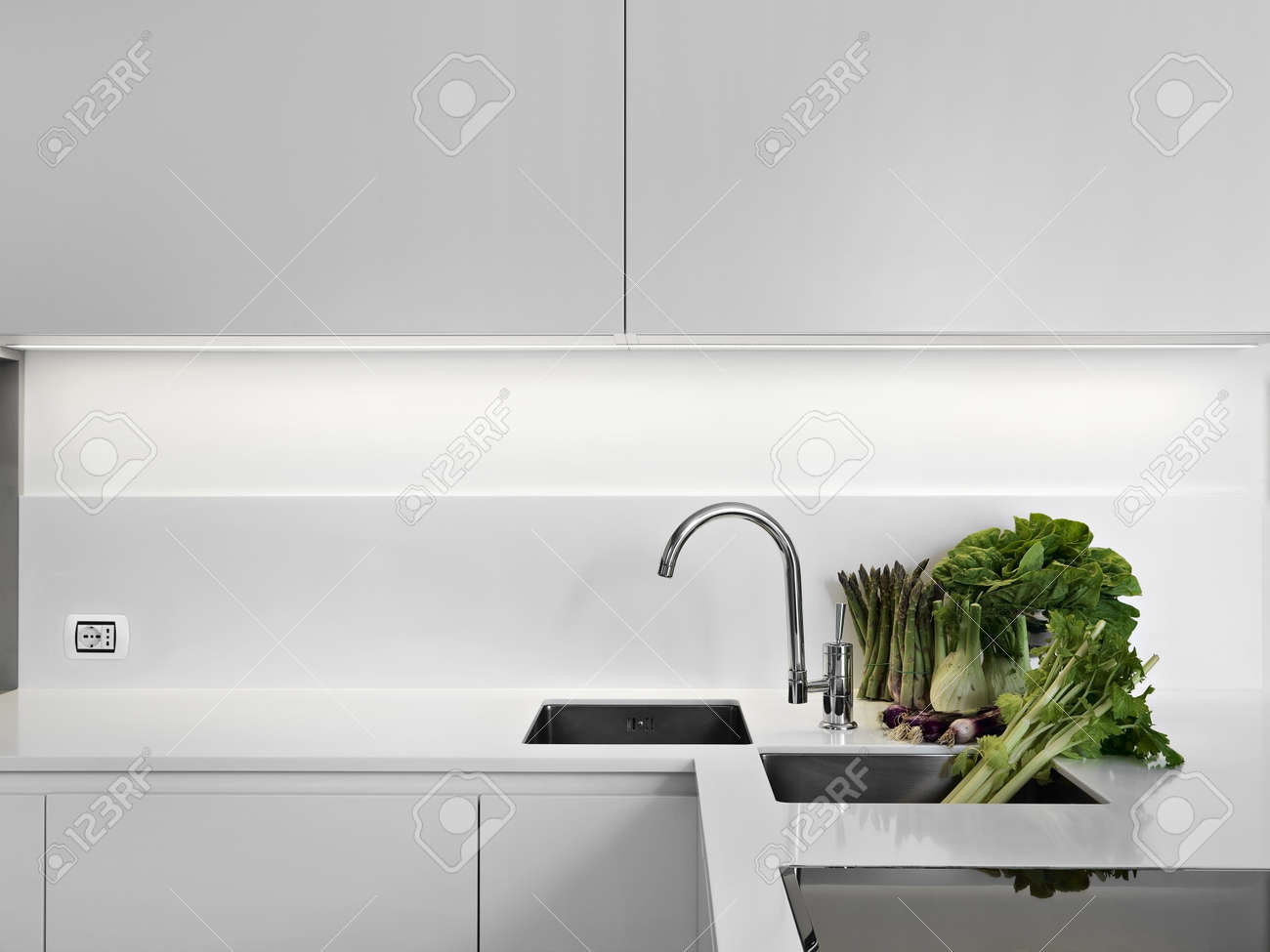 White Laminate Kitchen Worktops Modern White Laminate Kitchen With Vegetables On The White Worktop