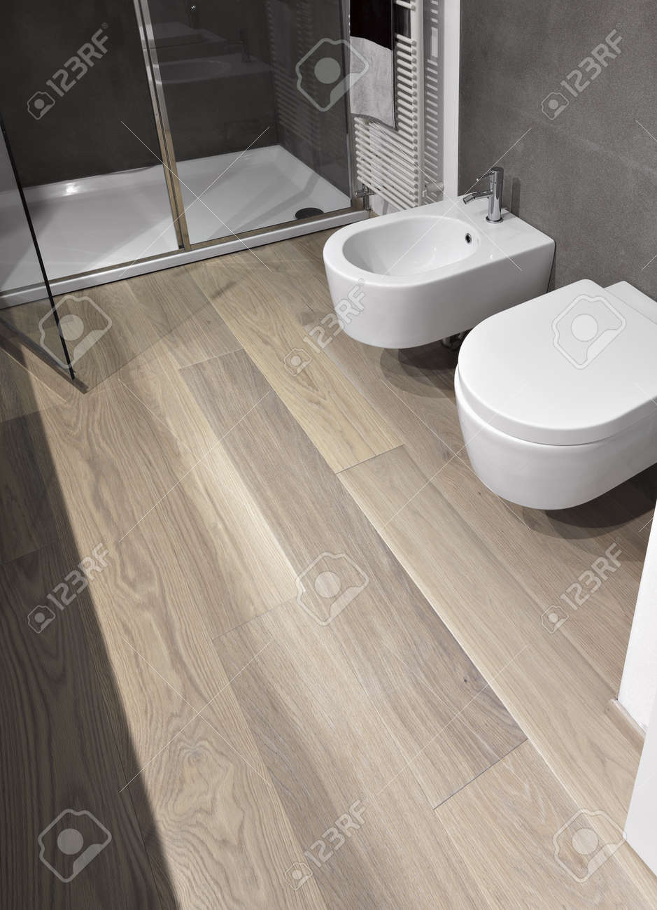 Sanitary In A Modern Bathroom With Wood Floor Stock Photo